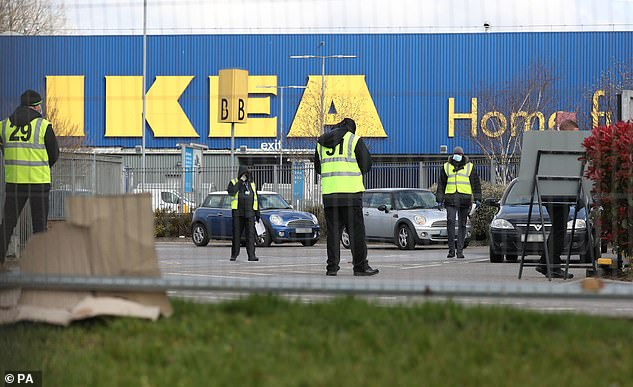 Pictured: Stewards organise traffic at a Covid-19 test centre for NHS workers which has opened at Ikea's store in Wembley, north-west London