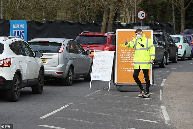 NHS staff were today finally being swabbed for coronavirus at a drive-through facility in Chessington, with queues of cars being waved through by a security guard in hi-vis jacket