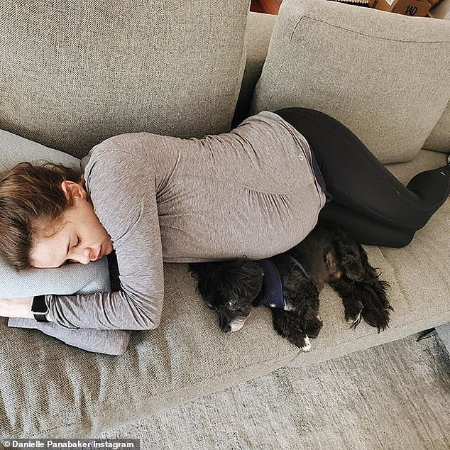 Snuggling:Last week she was seen napping on the sofa with her bump next to her dog. 'Thanks for the nomination @caitylotz #IStayHomeFor my grandparents and my family, for the healthcare workers who can¿t and fearlessly save lives'