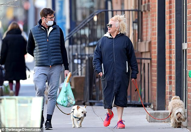 Light exercise: The couple also walked took their beloved dogs, Dali and Allegra, while out for their stroll