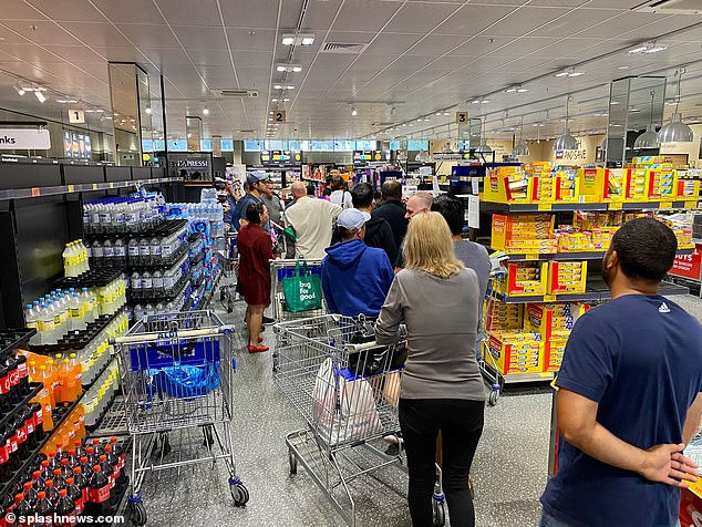 Shoppers cram into Aldi in Kellyville to stock up on supplies, flouting the 1.5 metre social distancing measures