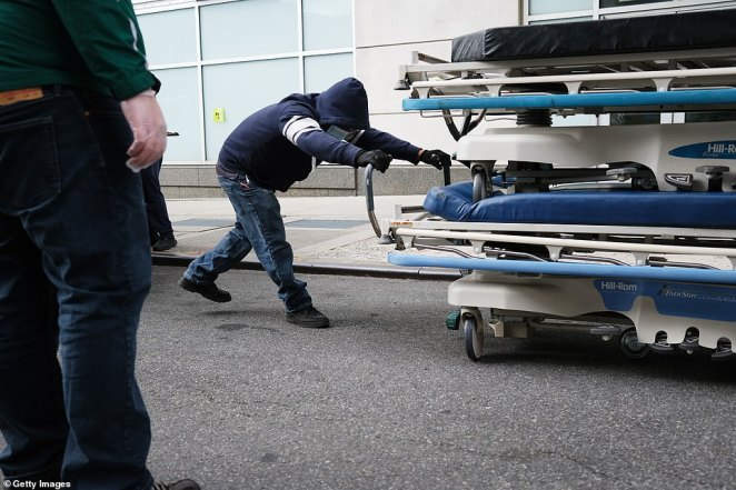 Extra medical beds are delivered to Maimonides Medical Center in Brooklyn. The US registered 911 deaths Thursday