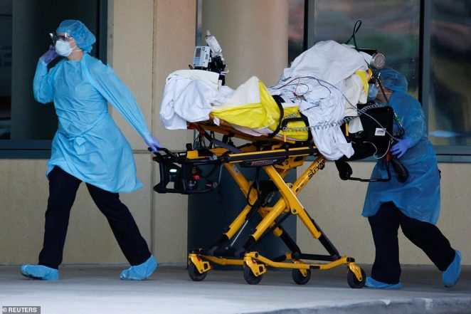 Rescue workers push a stretcher with a patient from the Zaandam of the Holland America Line cruise ship. There9,008 coronavirus cases in the state and have been 144 deaths as the state was finally placed into a lockdown this week