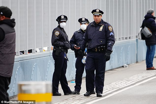 NYPD agents (like the ones pictured above on March 31) sacrificed their own health during the pandemic to protect New York residents