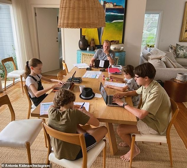 'Today's office': The journalist also recently posted a picture of Craig and four of her children sitting at the dining table, working on laptops or writing on school worksheets