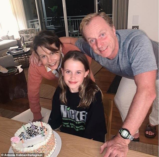 Just the family! Antonia and husband Craig Marran (right) celebrated her daughter Sybella's 13th birthday with 'cake and party games', while self-isolating at their Sydney home last weekend