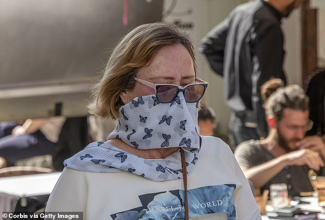 People around the world use scarves as makeshift masks (like this woman in Lisbon) because they don't have access to them