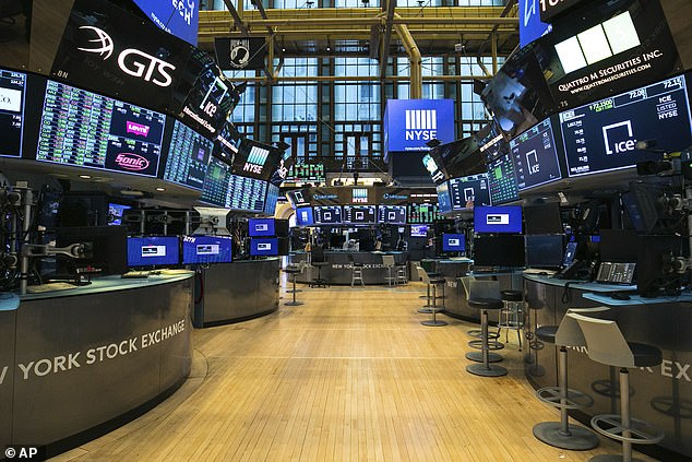 The empty New York Stock Exchange is seen in a file photo as traders work remotely during the pandemic. Stock futures slid on Friday as hopes of an oil price deal dwindled