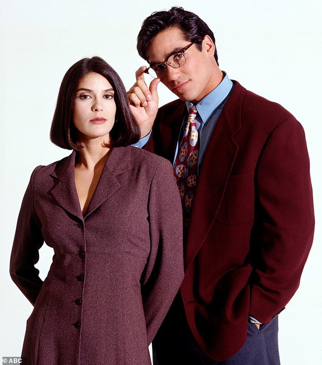 That famous bob: During the process, Teri references her 'Lois & Clark bob' before blow-drying her hair straight; pictured here with Superman Dean Cain