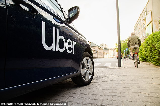 Uber announced previously that it may temporarily suspend accounts of riders and drivers who have tested positive for the coronavirus or been exposed to it at the direction of health authorities (stock)