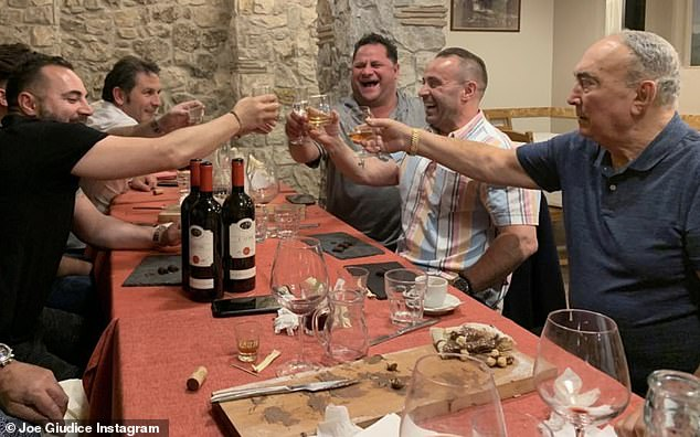 Drinking buddies: He also shared a photo of himself with Giacinto and some buddies at a table, sharing some drinks and some laughs