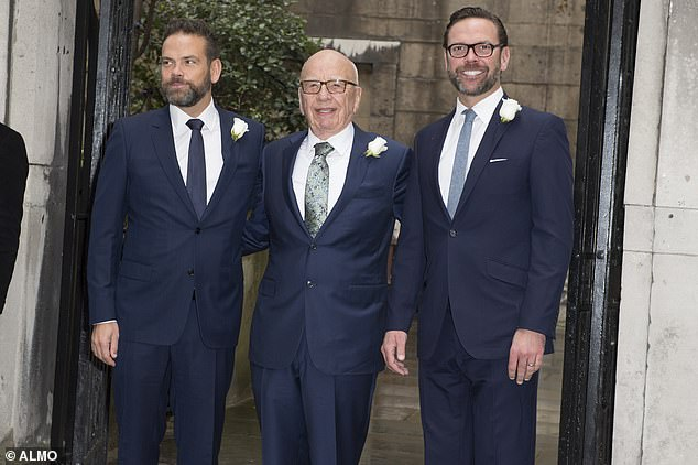 Rupert Murdoch (center), the owner of Fox News Channel, has been named in a lawsuit filed in Washington State accusing his network of downplaying the dangers of the coronavirus. Murdoch is seen with his sons Lachlan (left) and James (right) in this undated file photo