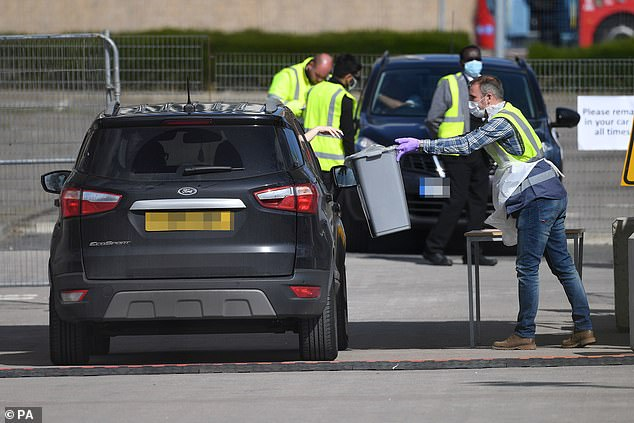 Public Health England (PHE), the body responsible for protecting the nation during health emergencies, has come in for criticism over the weak efforts to kickstart mass testing. Pictured: An NHS worker drives through a coronavirus testing site near The O2 in Greenwich, London