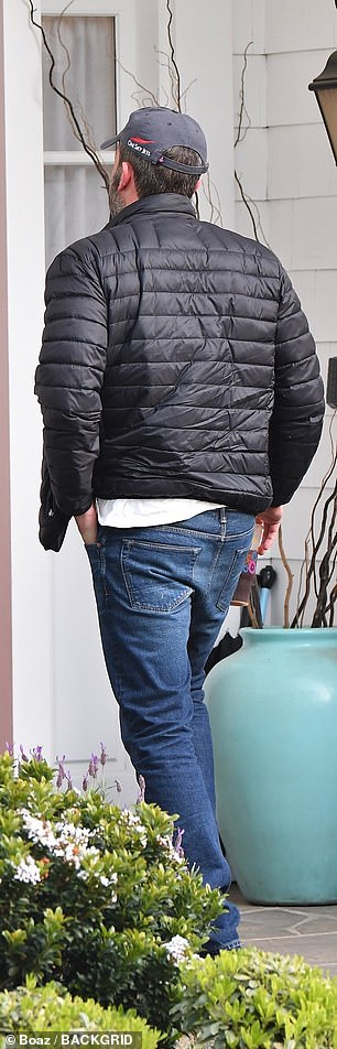 The look: Affleck, meanwhile, went for a casual look in blue jeans and a puffer jacket worn over a white T-shirt