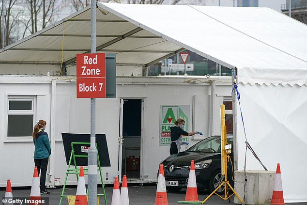A nurse can be seen taking a cotton swab from a test center behind the wheel of the Covid-19 at Manchester Airport on Saturday. Britain is about to enter its third week of lockouts, but Premier League footballer Kyle Walker has been criticized for paying escorts to come home