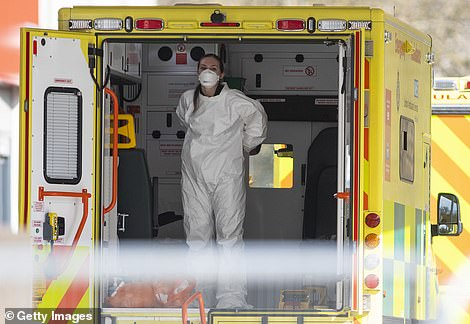 A medical worker is pictured in an ambulance outside St Thomas Hospital in London, where Prime Minister Boris Johnson is treated