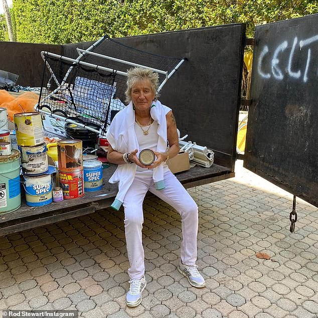 Use time wisely: Rod Stewart, 75, who is locked up in his Miami home with wife Penny Lancaster, 49, recently revealed that he spent his time in solitary confinement wiping out his garage