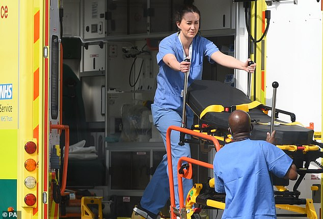 A 4,000-bed temporary hospital has been set up in London's ExCel center to treat patients diagnosed with COVID-19. Medical personnel are pictured unloading a stretcher on April 8
