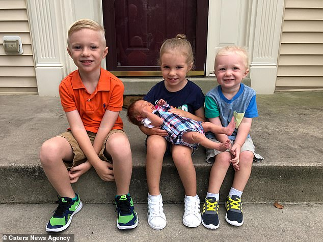 Pictured, Jett, six, Ella, five, holding Crew, seven months, and Nash, now three