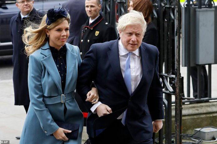 Carrie Symonds (pictured with her fiancé in March) also wrote to the Prime Minister after it was revealed that he was standing in a room in St Thomas', central London.