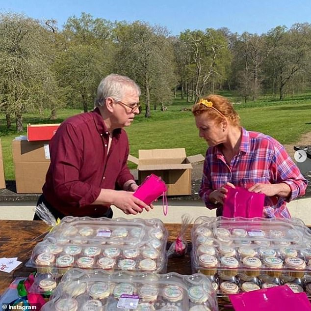 In the caption, Ms. Marshall explained that the pair were wrapping packages of Easter cakes and cookies to give to those at the nearby Thames hospice.