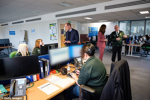 NHS 111 call handlers are pictured above. Kate Middleton and Prince William visited the workers last month
