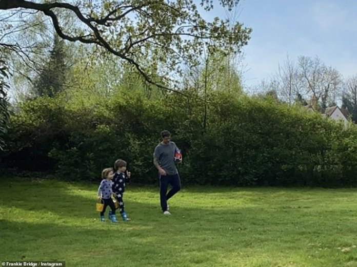 Dad adored: Frankie's husband Wayne, 39, led his sons to their huge garden in search of chocolate eggs