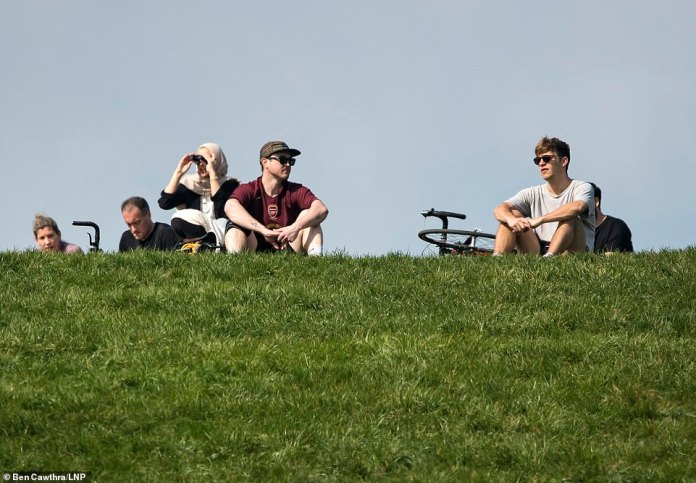 This group could be seen sitting in the sun atop Primrose Hill on Sunday morning. Groups are not allowed to gather outside, unless they all come from the same household. The public has been told repeatedly not to meet friends and family during the global pandemic, as Britain tries to slow the spread of the deadly disease.