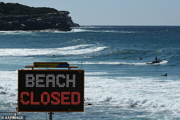 The Coast Guard tries to eliminate surfers in the water during the long Easter weekend at Bronte Beach in Sydney on Sunday