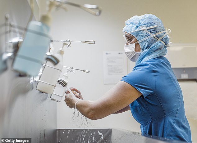 Personal protective equipment (PPE), laptops and petty cash were stolen. In the photo: a nurse wearing PPE washes her hands (stock image)