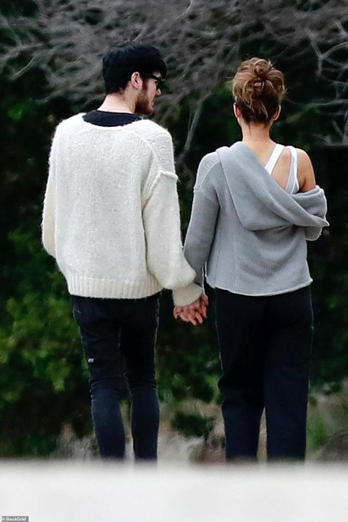 Hand in hand: the couple never left each other