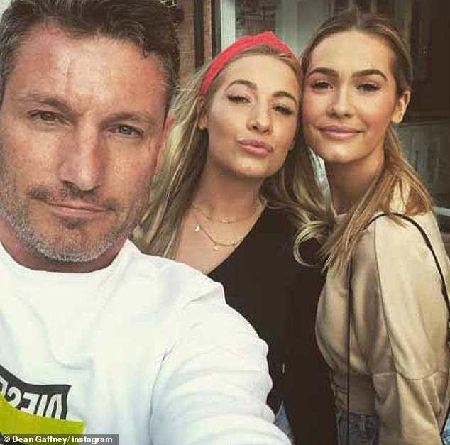 Happy: EastEnders star Dean Gaffney, 42, shared a photo of him with his twin daughters, Chloé (right) and Charlotte 23, on Monday as he said, `` The family is really all about this moment ''
