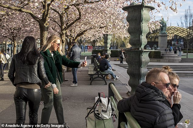 People hang out in Kungstradgarden Park in central Stockholm amid the new coronavirus pandemic (COVID-19) in Stockholm. Over 1,000 people have died from coronaviruses in Sweden and the number of confirmed cases has exceeded 11,000