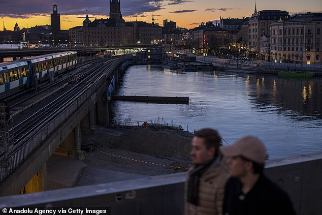 People pictured in central Stockholm amid the coronavirus pandemic. After a sharp increase in deaths in Sweden, Prime Minister Stefan Lofven proposed an emergency law allowing the rapid closure of public places and transport if necessary