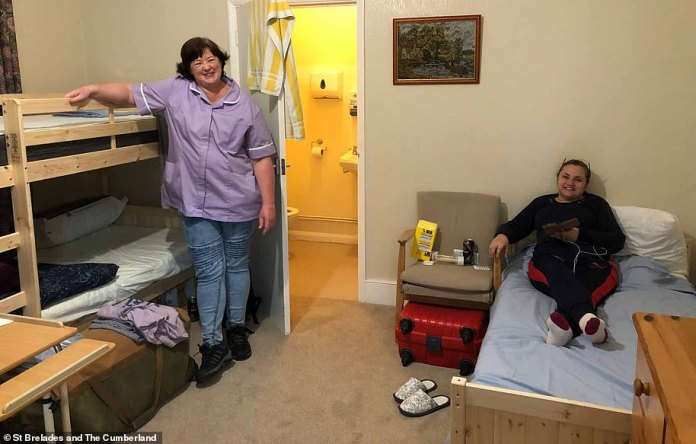 St Brelades and The Cumberland care home, in Herne Bay, Kent, looks after women suffering from dementia. It has been entirely locked down to outside visitors, and all carers and staff have now left behind their homes and families, to live in the care home. Pictured, the temporary bedroom the carers have created in one of the offices
