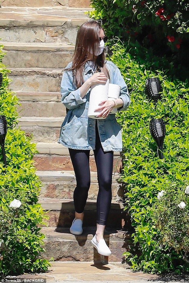 Out and about:Lily Collins, 31, stocked up on paper towels and toilet paper at a relative's Los Angeles home as California remains under lockdown amid the COVID-19 pandemic