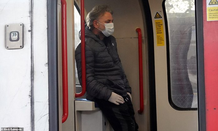 A passenger was spotted on the center line this morning wearing a face mask and gloves on the way to work. Many people still use the tubes