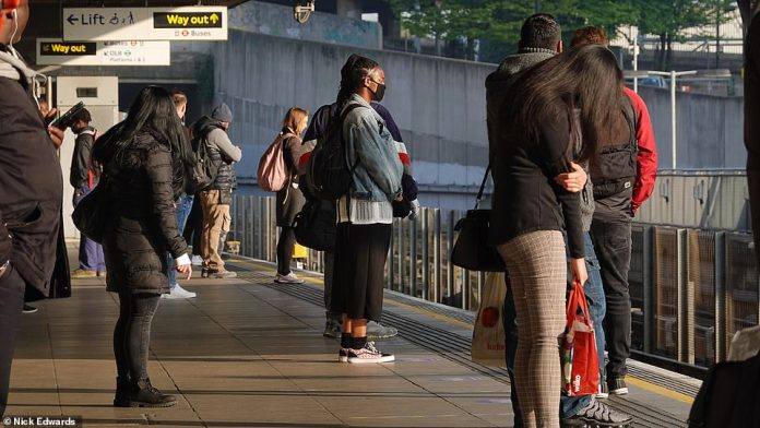 Passengers are seen at Canning Town station this morning as they wait for the Jubilee line. Some commuters have previously complained about the sporadic schedule