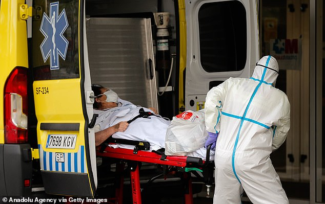 Yesterday a patient is transferred from an ambulance to an intensive care unit at the Gregorio Maranon hospital in Madrid