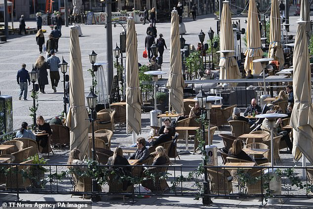 People sit outside in Stockholm on weekends, Swedish authorities still standing against the imposition of a lock