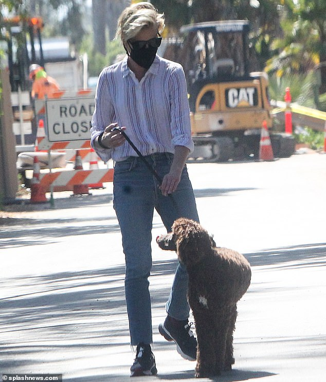Canine Company: Then Ellen DeGeneres' wife, 47, was seen wearing her black mask while walking with her dogs on the street