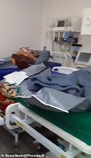 Near the patients being treated, body bags covered with blankets can also be seen on gurneys