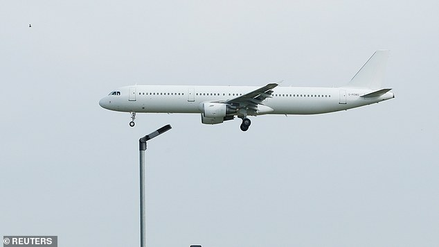 Workers arrived on a charter plane yesterday, which was photographed as it landed at Stanstead Airport