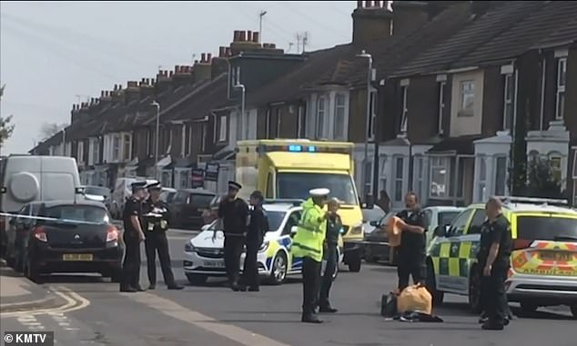 Police pictured at the scene of the collision on Thursday. Two men have been arrested
