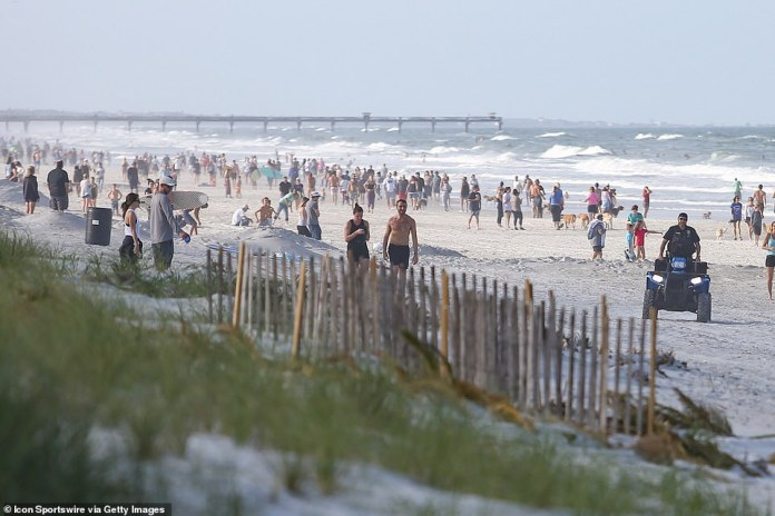 Thousands of people have rushed to the Florida shoreline (photo, Jacksonville Beach) after Governor Ron DeSantis gave municipalities the green light to reopen beaches and parks if they deemed it safe.