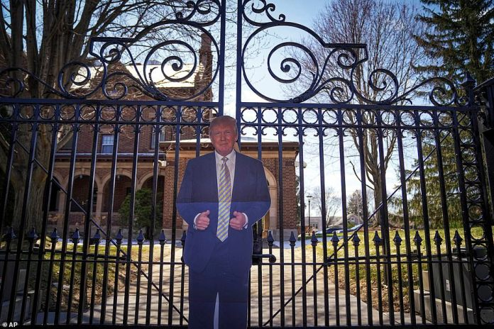 Friday, a cut out of cardboard from Donald Trump is placed in front of the official residence of the Governor of Minnesota in St. Paul.