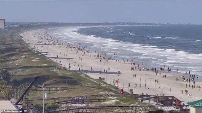 Thousands of Jacksonville residents hit the beaches on Friday as they reopened for the first time in weeks