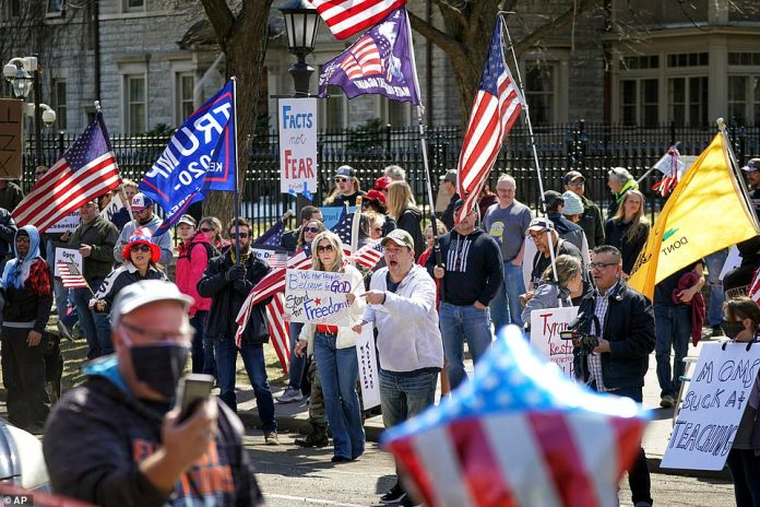 Some protesters wore masks while others did not, and very few practiced social distancing in Saint-Paul on Friday