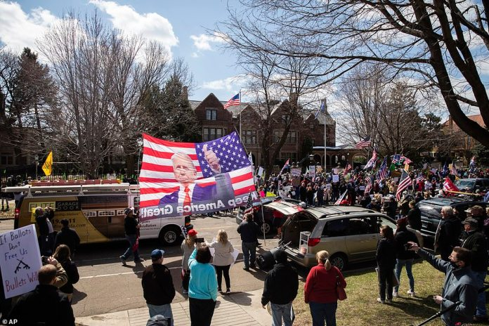 About 400 people attended the rally outside the governor's official residence in St. Paul, Minnesota, Friday