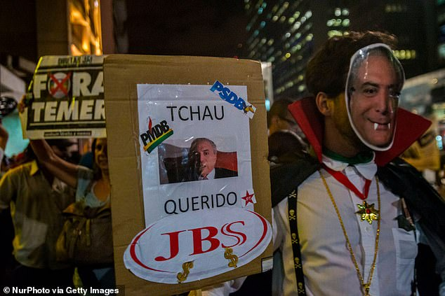 Investigation by Weld County Department of Public Health and the Environment found that 'work while sick' could cause the meat packing plant to become a COVID-19 hotspot (photo: Protestant vampire dress of President Michel Temer protesting in front of the Office of the President of the Republic on August 2, 2017 in Sao Paulo, Brazil)